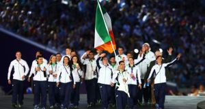 Boxer Katie Taylor leads the Ireland team into the stadium during the opening ceremony for the  2015 European Games at the National Stadium  in Baku, Azerbaijan. Photograph: Francois Nel/Getty Images