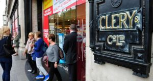 Shoppers leave Clerys department store in O'Connell Street, Dublin. Photograph: Aidan Crawley
