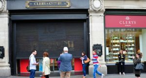 The shutters come down at the entrance to Clerys Department Store in O'Connell Street, Dublin. Photograph: Aidan Crawley
