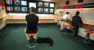 The loss-making Ladbrokes Ireland plans to close 60 of its 196 betting shops and cut 250 of its 840 jobs under a rescue plan. Photograph: Cyril Byrne