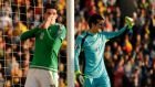 Northern Ireland's Kyle Lafferty after failing to score agaings   Romanian goalkeeper Ciprian Tatarusanu at Windsor Park on Saturday. Photograph: Reuters