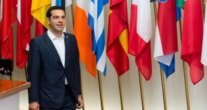 'Greece is more right than its critics. One doesn't have to agree with the politics of the far-left in Greece to vindicate the integrity of the economic case they bring to the table.' Above,  Greek prime minister Alexis Tsipras walks in front of European flags after he participated in a bilateral meeting with European Commission President Jean-Claude Juncker on the sidelines of the EU meetings in Brussels on  June 11th, 2015. Photograph: AP Photo/Geert Vanden Wijngaert