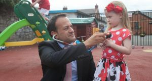 Minister for Health Leo Varadkar and Kiya O'Connor at the launch of the online registration system for  free GP care for children under six at St Andrew's Resource Centre, Pearse Street, Dublin. Photograph: Gareth Chaney Collins