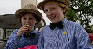 Joyceans at Glasnevin Cemetery: Sebastian and Hugo Norrris, from Leeson Street, Dublin enjoying Bloomsday. Photograph: Colm Mahady / Fennells