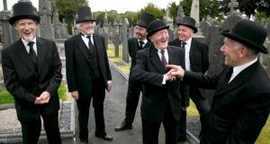 Joyceans in full bloom at Glasnevin Cemetery. Pictured were actors: Louis O'Byrne who plays Martin Cunningham, Jim O' Keeffe, who plays Jack Power, Blaise Reid who plays Narrator/ Cab Driver, Val O' Donnell character of Simon Dedalus, Michael Carolan, Bloom's Narrator, Ian Blackmore who plays Leopold Bloom. Photograph: Colm Mahady / Fennells