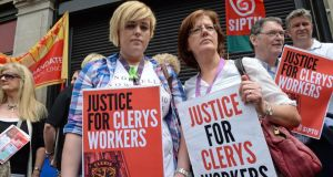 Clerys workers Emily McDermott  and her daughter Nathania, at the demonstration in support of Clerys workers, outside the store in O'Connell Street, Dublin. Photograph: Eric Luke / The Irish Times