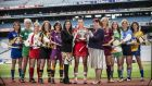 The captains of all ten teams in this year's Liberty Insurance All-Ireland Senior Camogie Championship with Catherine Neary, Camogie Association president and Annette Ní Dhathlaoí (Liberty Insurance) at the  launch in Croke Park. Photo: Cathal Noonan/Inpho
