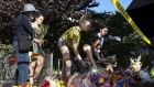 Visitors lay flowers on a makeshift memorial near the scene of the Berkeley balcony collapse. Photograph: Elijah Nouvelage/Reuters