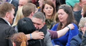Family members console each other at the funeral of Steve Harris (34). Photograph: Colin Keegan/Collins.