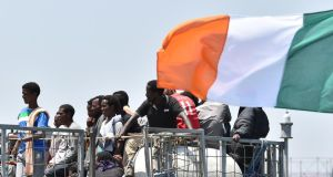 'There is rightly much pride in the life-saving work of the LÉ Eithne and its crew.' Above, migrants wait to  disembark from the Irish Naval ship  LÉ Eithne at the Catania harbour,  on June 16th, 2015. Photograph: AP Photo/Carmelo Imbesi