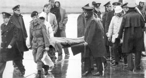 A victim of the Air India bombing which killed 329 people on June 23rd, 1985,  is removed from Cork Airport on a stretcher.