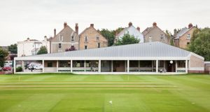 Taka Architects won best leisure award for the Merrion Cricket Pavilion in Dublin where the angled silver roof speaks gently to the pitched roofs nearby