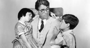 Gregory Peck  as Atticus Finch with Mary Badham as Scout and Phillip Alford as Jem in To Kill A Mockingbird, directed by Robert Mulligan. Photograph: Silver Screen Collection/Getty Images
