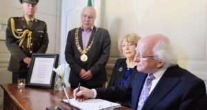 President Michael D Higgins signs a Book of Condolence at the Mansion House in Dublin on Thursday for the victims of the Berkeley balcony tragedy. Photograph: Alan Betson/The Irish Times