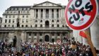 Protestors march through central London during a demonstration against austerity and spending cuts. Photograph: Jeff J Mitchell/Getty Images