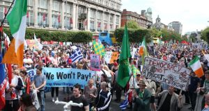 Protesters on O'Connell Street, Dublin, during a demonstration against water charges. Photograph: Brian Lawless/PA