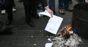 Protesters burn their water bills on O'Connell Street, Dublin. Photograph: Brian Lawless/PA