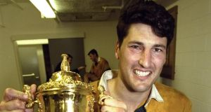 Australia captain John Eales holds the Webb Ellis trophy after winning the final of the 1999 Rugby World Cup against France  at the Millennium Stadium in Cardiff. A number of Australian media companies  will not send journalists and photographers to this year's event  because of what they say are unreasonable restrictions on covering the event. Photo:  Dave Rogers /Allsport