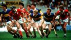 Cork and Tipperary players follow the ball during the 1987 Munster hurling final replay played at Fitzgerald Stadium, Killarney. Photograph: Billy Stickland/Inpho.