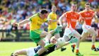 Martin O'Reilly scores Donegal's  second goal against Armagh. Oisín McConville can't see Derry stopping Rory Gallagher's side either. Photograph: Andrew Paton/Presseye/Inpho