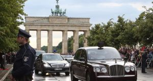 Queen Elizabeth and Prince Philip pass the Brandenburg Gate during the British monarch's visit to Berlin. Photograph: Stephanie Pilick/EPA