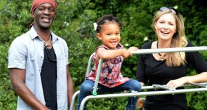 Lefah Ballo with his partner, Caitríona Rodgerson, and their daughter, Nina, in Churchtown, Dublin. The couple met in Africa in 2012. Photograph: Eric Luke