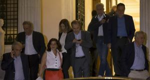 Greek ministers leave the Maximos Mansion after a governmental council in Athens on Saturday. Greece will hold a referendum on July 5th to decide whether the country should accept or reject a bailout agreement offered by creditors. Photograph: Reuters