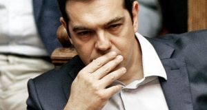 Greece's prime minister Alexis Tsipras attends an emergency Parliament session for the government's proposed referendum in Athens. Photograph: Milos Bicanski/Getty Images