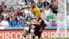 Meath's goalkeeper Paddy O'Rourke was given a red card for this collision with Kieran Martin. Photograph: James Crombie/Inpho