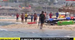 A screengrab from Sky News showing  Seifeddine Rezgui on the beach ear the Imperial Marhabada hotel with a gun shortly before the attack in which 39 people were killed. Photograph: Sky News