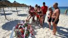 Tourists lay flowers in tribute to the people killed in a terror attack on a beach in front of the imperial Marhaba Hotel in al-Sousse. Photograph: EPA