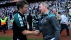 Managers Jason Ryan and Jim Gavin shake hands at the end of the game. Photograph: Donall Farmer/Inpho