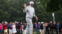 Bubba Watson holds up his ball on the 15th green during the final round of the Travelers Championship at TPC River Highlands. Photograph: Jim Rogash/Getty Images