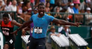 Justin Gatlin points at the clock as he celebrates winning the  200 metres at the USA Track & Field Championships in Eugene, Oregon. Photograph: Christian Petersen/Getty Images