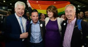 Alex White, John Lyons, Tánaiste Joan Burton and Kevin Humphreys photographed at the referendum count last month. Legislation to provide for same sex marriage is to be delayed until after the summer recess. Photograph: Cyril Byrne