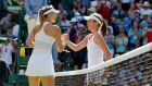 Maria Sharapova of Russia shakes the hand of Johanna Konta of Britain after winning their first round match at the Wimbledon Tennis Championships. Photo: Suzanne Plunkett/Reuters