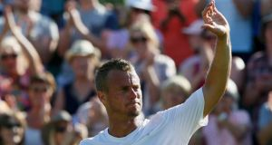 Lleyton Hewitt waves goodbye to the fans on Court Two after he was beaten in the first round of Wimbledon by Jarkko Nieminen. Photo: Stefan Wermuth
