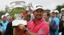 Northern Irishman golfer Graeme McDowell poses with his trophy after winning the 2014 Alstom Open de France on. Photo: Thomas Sampson/Getty Images