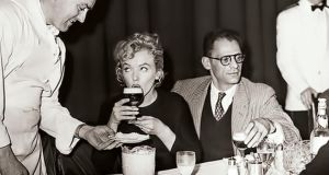 In 1943 chef Joe Sheridan served whiskey with hot coffee and topped the glass with cream to airline passengers. A passenger thanked Sheridan, asking if the wonderful coffee was Brazilian. Sheridan reportedly replied tongue-in-cheek, 'No, that was Irish Coffee', and so the now famous drink got its name. The photograph shows Marilyn Monroe and her then husband Arthur Miller having an Irish Coffee at Shannon during a short stop-over in Ireland in November 1956.