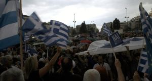 Protesters supporting a 'Yes' to the referendum and demanding Greece to remain in the Eurozone rally outside the Greek Parliament in Athens, Greece. Photograph: EPA