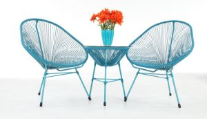 Como is a set of two chairs and a glass-topped side table available in teal blue  or lime green, reduced from €699 to €399 at EZ Living