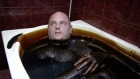 Bathing in black gold: spa treats customers in crude oil
