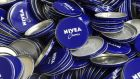 Tins of Nivea skin cream are pictured on a production line of German company Beiersdorf in Hamburg. Euro zone factory growth remained tepid as Greek debt talks, and the country's possible departure from the bloc, dominated debate in Europe. Photo: Reuters