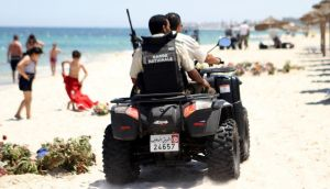 Tunisian security forces patrol a beach in Sousse, south of the capital Tunis, on Wednesday. Photograph: Getty