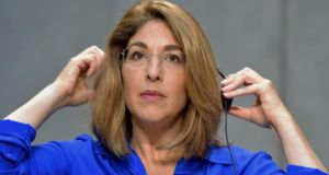 Canadian social activist Naomi Klein gestures during a press conference at the Vatican on Wednesday. Vincenzo Pinto/AFP/Getty Images.