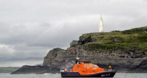 A  lifeboat searches off the coast of Baltimore, Co Cork. Photograph: Provision