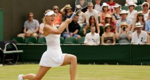 Maria Sharapova  hits a forehand during her match against Richel Hogenkamp at Wimbledon. Photograph: Henry Browne/Reuters