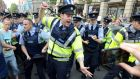 Anti-water charge protesters scuffle with Gardaí outside the Dáil. Photograph: Dave Meehan