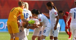 England's Laura Bassett is concoled by team mates after her own goal sent Japan through to the World Cup final. Photograph: Getty