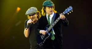 Brian Johnson and Angus Young of AC/DC performs onstage at Aviva Stadium on July 1, 2015 in Dublin, Ireland. (Photo by Carrie Davenport/Redferns via Getty Images)